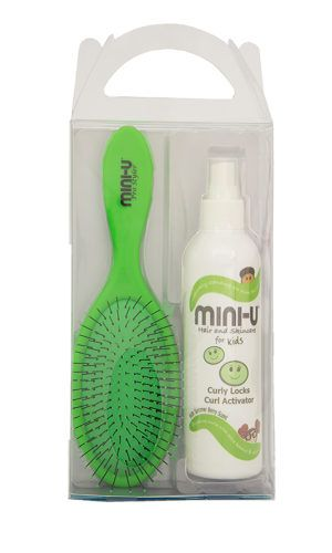 View of a green pro styler hair brush and a bottle of curly locks activator in a gift set