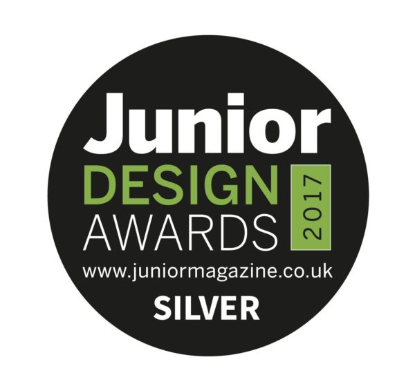 View of the junior design award 2017 featuing white and green text on a black circle